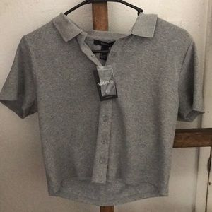A knit sleeveless shirt in heather grey